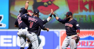 Cleveland Indians shortstop Francisco Lindor, third baseman Jose Ramirez and first baseman Carlos Santana