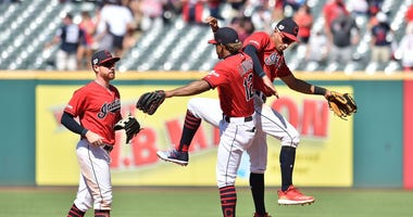 Cleveland Indians left fielder Jordan Luplow celebrates with shortstop Francisco Lindor and center fielder Oscar Mercado
