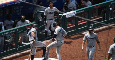 Marlins players celebrate after a home run on July 26