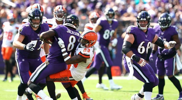 Browns safety Damarious Randall tackles Ravens quarterback Lamar Jackson