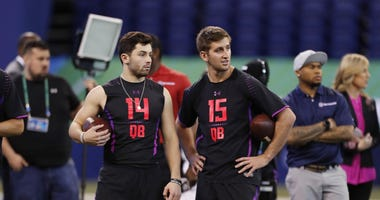 Mar 3, 2018; Indianapolis, IN, USA; Oklahoma Sooners quarterback Baker Mayfield (14) and UCLA Bruins quarterback Josh Rosen (15) wait for their turn to throw in work out drills during the 2018 NFL Combine at Lucas Oil Stadium. Mandatory Credit: Brian Spur