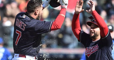 Apr 8, 2018; Cleveland, OH, USA; Cleveland Indians catcher Yan Gomes (7) celebrates with first baseman Yonder Alonso (17) after hitting a game-winning two-run home run against Kansas City during the ninth inning Sunday.