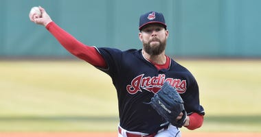 Apr 9, 2018; Cleveland, OH, USA; Cleveland Indians starting pitcher Corey Kluber (28) throws a pitch during the first inning against the Detroit Tigers at Progressive Field.