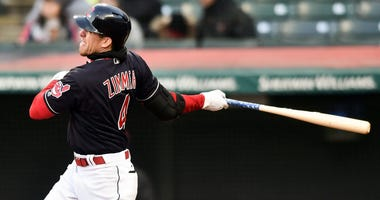 Apr 9, 2018; Cleveland, OH, USA; Cleveland Indians center fielder Bradley Zimmer (4) hits a two run home run during the fifth inning against the Detroit Tigers at Progressive Field.