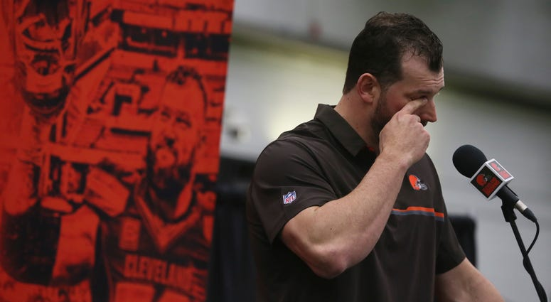Cleveland Browns offensive tackle Joe Thomas wipes away a tear after learning the beat writers renamed the player of the year award the Joe Thomas award during his retirement press conference at the Cleveland Browns training facility on Monday, March 19,