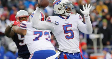 Dec 24, 2017; Foxborough, MA, USA; Buffalo Bills quarterback Tyrod Taylor (5) throws a pass against the New England Patriots in the second half at Gillette Stadium. Mandatory Credit: David Butler II-USA TODAY Sports