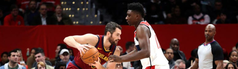 WASHINGTON, DC - NOVEMBER 08: Kevin Love #0 of the Cleveland Cavaliers drives against Thomas Bryant #13 of the Washington Wizards in the first half at Capital One Arena on November 08, 2019 in Washington, DC.