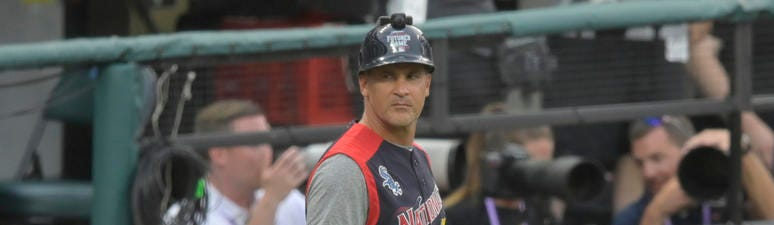 American League coach Omar Vizquel stands on the field in the fourth inning against the National League in the 2019 MLB All Star Futures Game at Progressive Field.