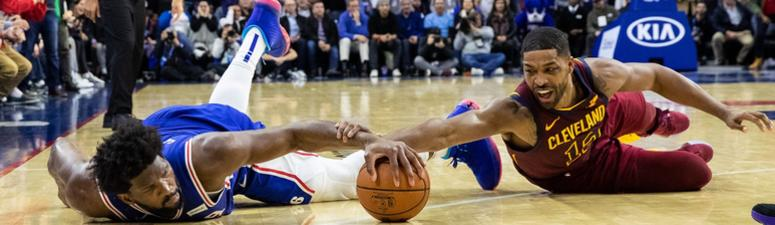 Nov 12, 2019; Philadelphia, PA, USA; Philadelphia 76ers center Joel Embiid (21) dives for a loose ball past Cleveland Cavaliers center Tristan Thompson (13) in the final second of the game at Wells Fargo Center. Mandatory Credit: Bill Streicher-USA TODAY