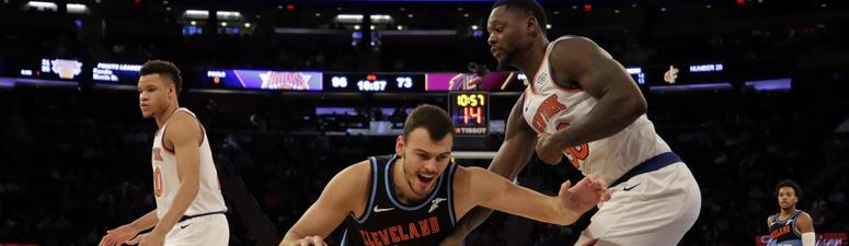 Nov 18, 2019; New York, NY, USA; Cleveland Cavaliers center Ante Zizic (41) falls to the court while being defended by New York Knicks forward Julius Randle (30) during the second half at Madison Square Garden. Mandatory Credit: Adam Hunger-USA TODAY Spor