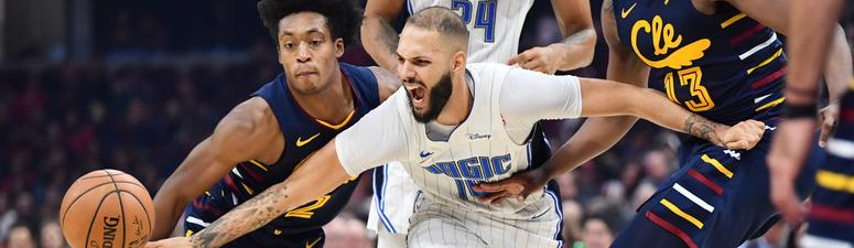 Dec 6, 2019; Cleveland, OH, USA; Cleveland Cavaliers guard Collin Sexton (2) and Orlando Magic guard Evan Fournier (10) fight for posession of the ball during the first half at Rocket Mortgage FieldHouse. Mandatory Credit: Ken Blaze-USA TODAY Sports