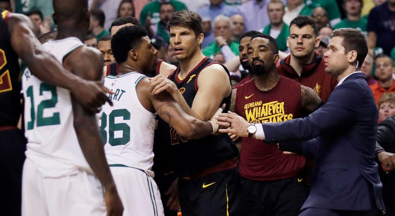 Cleveland Cavaliers and Boston Celtics players hold each other back after shoves between Celtics forward Marcus Morris andCavaliers forward Larry Nance Jr. during the second quarter of Game 5 of the NBA basketball Eastern Conference finals