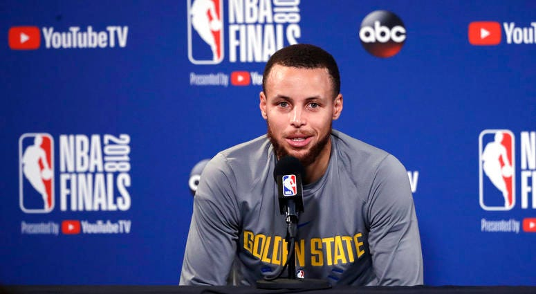 Golden State Warriors' Stephen Curry answers questions after an NBA basketball practice, Wednesday, May 30, 2018, in Oakland, Calif. The Warriors face the Cleveland Cavaliers in Game 1 of the NBA Finals on Thursday in Oakland.