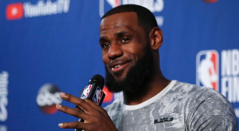 Cleveland Cavaliers forward LeBron James takes questions at a press conference after the basketball team's practiced during the NBA Finals, Thursday, June 7, 2018, in Cleveland. The Warriors lead the series 3-0 with Game 4 on Friday.