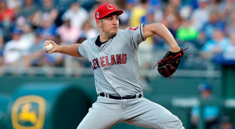 Cleveland Indians starting pitcher Trevor Bauer delivers to a Kansas City Royals batter during the first inning of a baseball game at Kauffman Stadium in Kansas City, Mo., Wednesday, July 4, 2018.