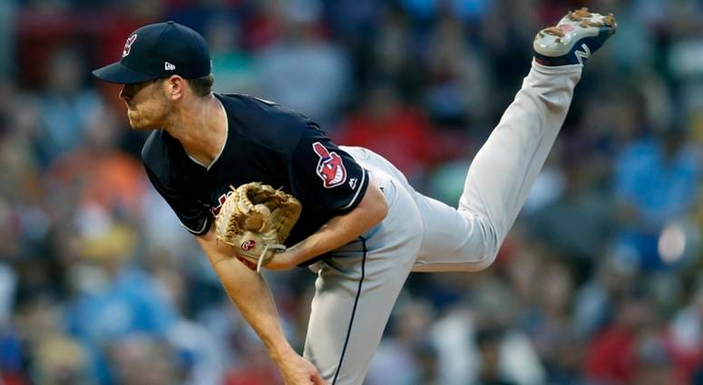 Cleveland Indians' Shane Bieber pitches during the first inning of a baseball game against the Boston Red Sox in Boston, Tuesday, Aug. 21, 2018.