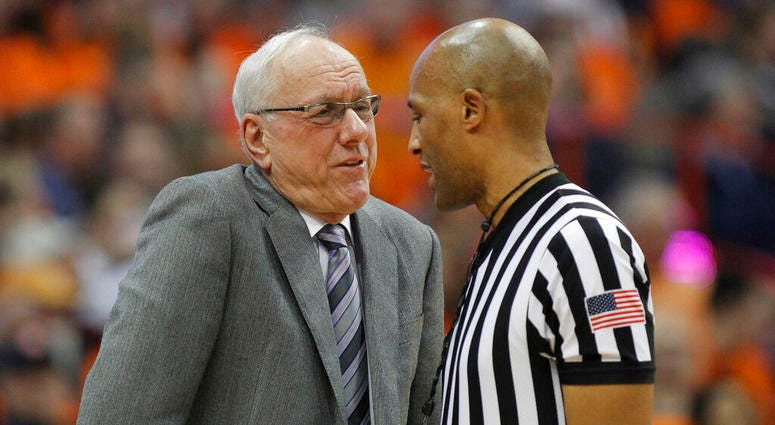 Syracuse head coach Jim Boeheim, left, talks to an official about a call during the second half of an NCAA college basketball game against Louisville in Syracuse, N.Y., Wednesday, Feb. 20, 2019. Syracuse won 69-49. (AP Photo/Nick Lisi)