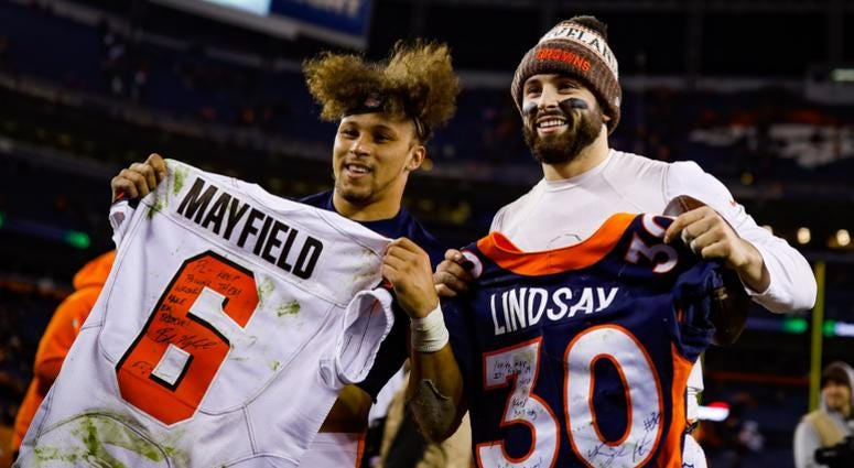 DENVER, CO - DECEMBER 15: Running back Phillip Lindsay #30 of the Denver Broncos and quarterback Baker Mayfield #6 of the Cleveland Browns stand with exchanged jerseys after a game at Broncos Stadium at Mile High on December 15, 2018 in Denver, Colorado.