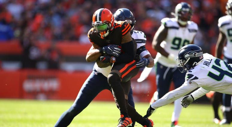 CLEVELAND, OHIO - OCTOBER 13: Odell Beckham #13 of the Cleveland Browns is tackled by K.J. Wright #50 of the Seattle Seahawks and Lano Hill #42 after a third quarter catch at FirstEnergy Stadium on October 13, 2019 in Cleveland, Ohio. (Photo by Gregory Sh