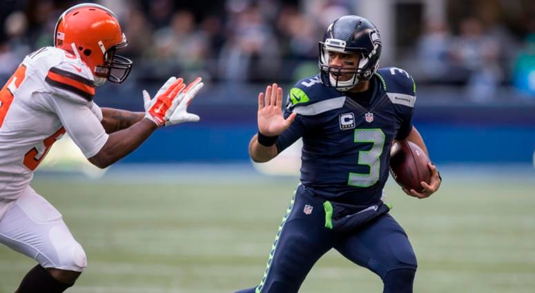 SEATTLE, WA - DECEMBER 20: Quarterback Russell Wilson #3 of the Seattle Seahawks runs with the ball during the first half of a football game against the Cleveland Browns at CenturyLink Field on December 20, 2015 in Seattle, Washington. The Seahawks won th