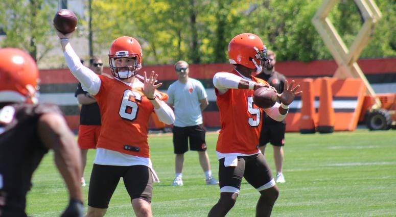 Browns quarterbacks Baker Mayfield (No. 6) and Tyrod Taylor (No. 5) throw during OTAs