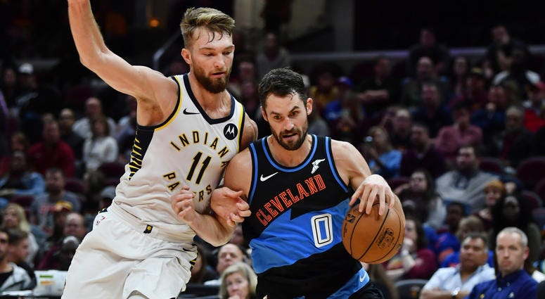 Oct 26, 2019; Cleveland, OH, USA; Cleveland Cavaliers forward Kevin Love (0) drives to the basket against Indiana Pacers forward Domantas Sabonis (11) during the second half at Rocket Mortgage FieldHouse. Mandatory Credit: Ken Blaze-USA TODAY Sports
