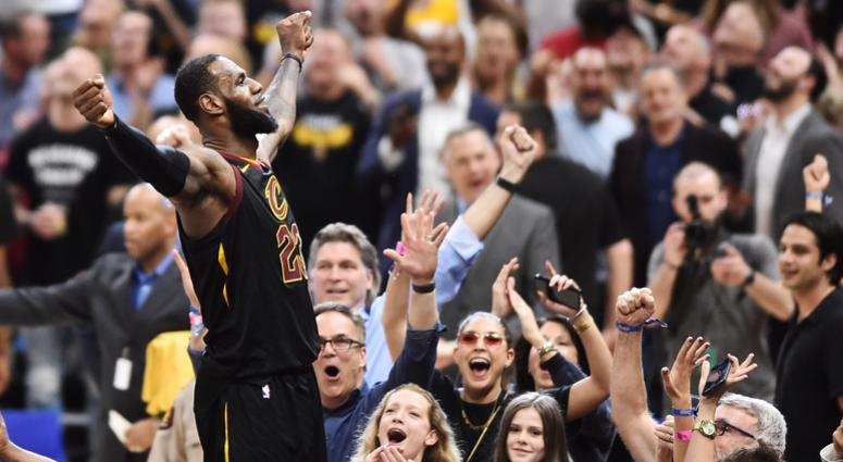 May 5, 2018; Cleveland, OH, USA; Cleveland Cavaliers forward LeBron James (23) stands on the scorer's table after hitting the final shot to win the game against the Toronto Raptors in game three of the second round of the 2018 NBA Playoffs at Quicken Loan