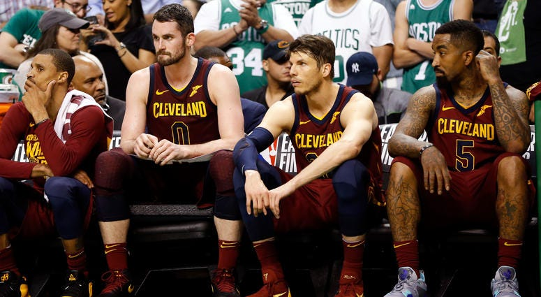 leveland Cavaliers center Kevin Love (0), guard Kyle Korver (26), and guard JR Smith (5) watch the end of the fourth quarter against the Boston Celtics in game two of the Eastern conference finals of the 2018 NBA Playoffs at TD Garden.