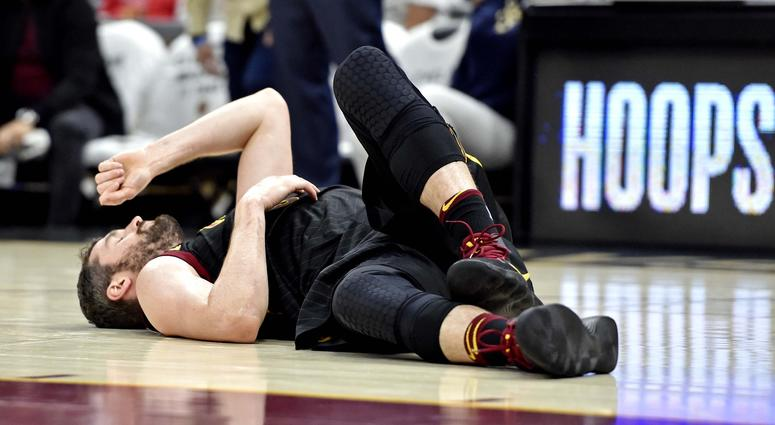 Cleveland Cavaliers center Kevin Love (0) reacts after being injured during the first quarter against the Boston Celtics in game six of the Eastern conference finals of the 2018 NBA Playoffs at Quicken Loans Arena.