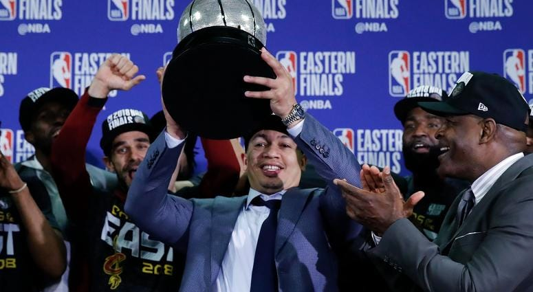 Cleveland Cavaliers head coach Tyronn Lue holds up the Eastern Conference trophy after defeating the Boston Celtics in the 2018 NBA Playoffs at TD Garden.