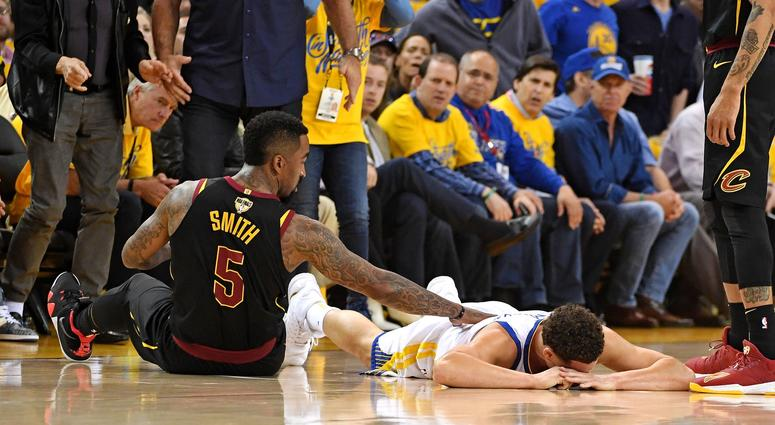 Golden State Warriors guard Klay Thompson (11) reacts after an apparent injury during the first quarter against Cleveland Cavaliers guard JR Smith (5) in game one of the 2018 NBA Finals