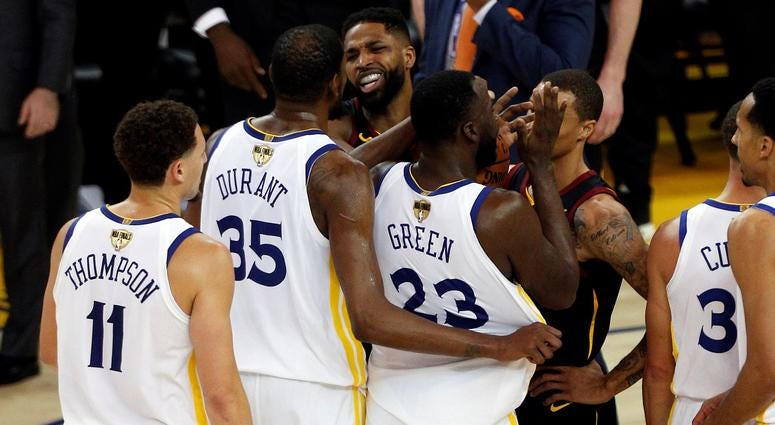 Cleveland Cavaliers center Tristan Thompson (13) is involved in an altercation with Golden State Warriors forward Draymond Green (23) during overtime in game one of the 2018 NBA Finals at Oracle Arena.