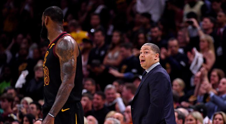 Cleveland Cavaliers head coach Tyronn Lue talks with forward LeBron James (23) during the second quarter against the Golden State Warriors in game four of the 2018 NBA Finals at Quicken Loans Arena.