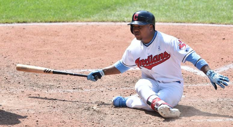 Jun 17, 2018; Cleveland, OH, USA; Cleveland Indians third baseman Jose Ramirez (11) falls to the ground after striking out in the seventh inning against the Minnesota Twins at Progressive Field.