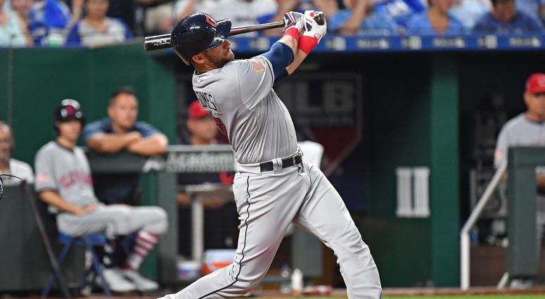 Cleveland Indians catcher Yan Gomes (7) hits a grand slam home run during the sixth inning against the Kansas City Royals at Kauffman Stadium.