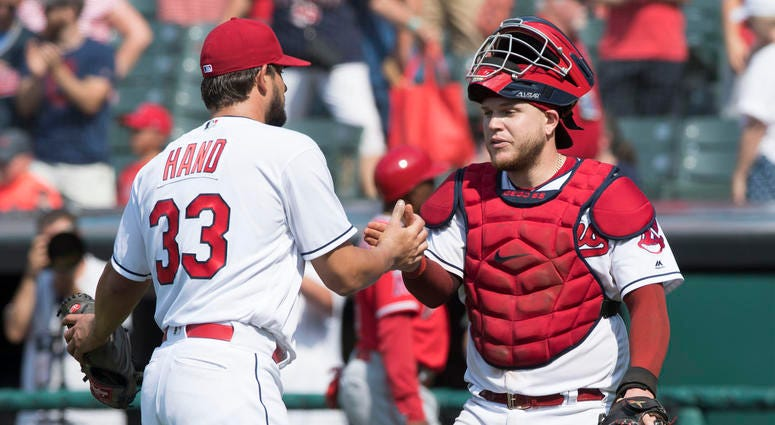Aug 5, 2018; Cleveland, OH, USA; Cleveland Indians relief pitcher Brad Hand (33) and catcher Roberto Perez (55) celebrate after the Indians beat the Los Angeles Angels at Progressive Field.