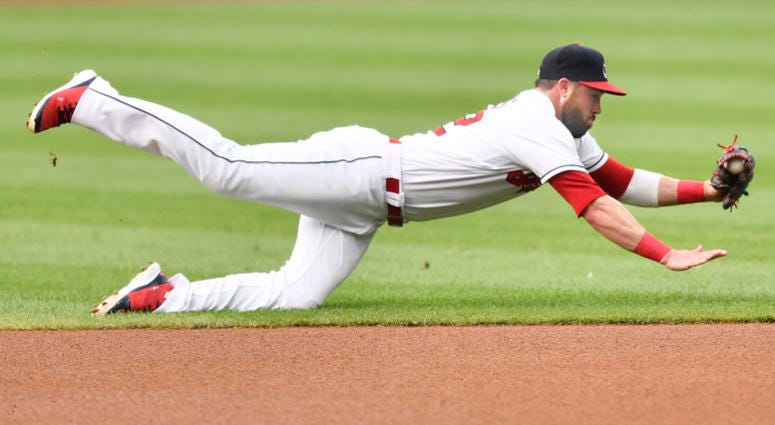 Aug 6, 2018; Cleveland, OH, USA; Cleveland Indians second baseman Jason Kipnis (22) makes a diving stop on a ground ball in the first inning against the Minnesota Twins at Progressive Field.