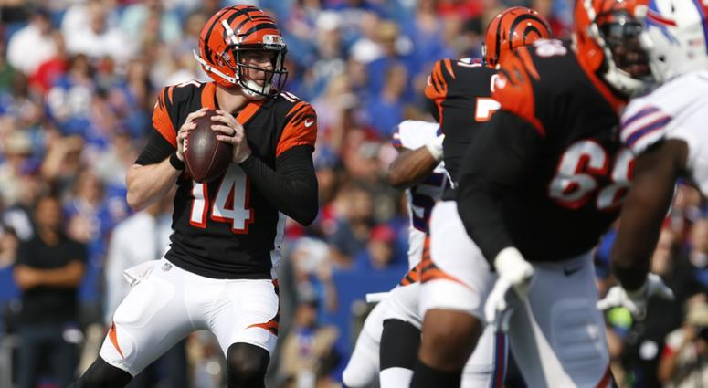 Cincinnati Bengals quarterback Andy Dalton (14) looks to throw a pass during the first half against the Buffalo Bills at New Era Field.
