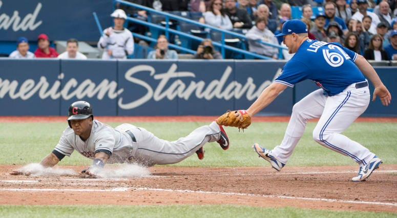 Sep 8, 2018; Toronto, Ontario, CAN; Cleveland Indians third baseman Jose Ramirez (11) slides into home plate ahead of the tag from Toronto Blue Jays relief pitcher Mark Leiter Jr. (62) during the sixth inning at Rogers Centre.