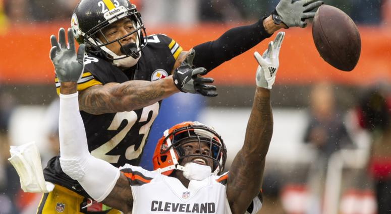 Pittsburgh Steelers defensive back Joe Haden (23) breaks up a pass intended for Cleveland Browns wide receiver Josh Gordon (12) during the third quarter at FirstEnergy Stadium.