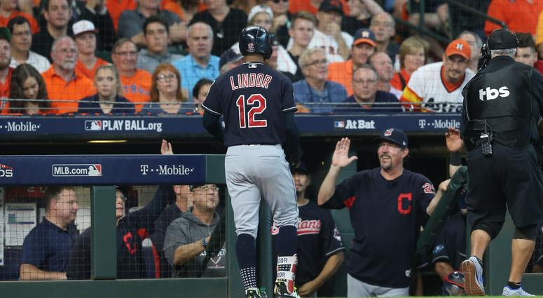 Cleveland Indians shortstop Francisco Lindor (12) celebrates with manager Terry Francona (77) after hitting a solo home run during the third inning against the Houston Astros during game two of the 2018 ALDS playoff baseball series at Minute Maid Park.
