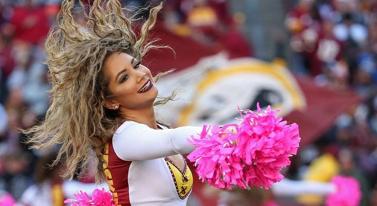 Oct 21, 2018; Landover, MD, USA; A Washington Redskins cheerleader dances on the field during a timeout against the Dallas Cowboys at FedEx Field. Mandatory Credit: Geoff Burke-USA TODAY Sports