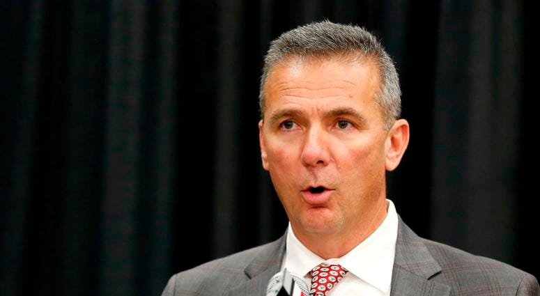 hio State Buckeyes head coach Urban Meyer (left) addresses members of the media to announce his intentions to step down from coaching after the Rose Bowl game. Meyer is pictured with newly named head coach Ryan Day during the press conference at the Ohio