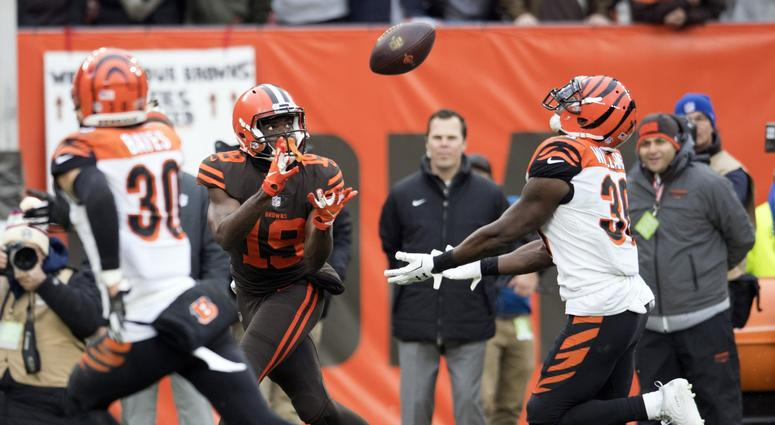 Dec 23, 2018; Cleveland, OH, USA; Cleveland Browns wide receiver Breshad Perriman (19) catches a pass as Cincinnati Bengals free safety Jessie Bates (30) and strong safety Shawn Williams (36) defend during the first half at FirstEnergy Stadium. Mandatory