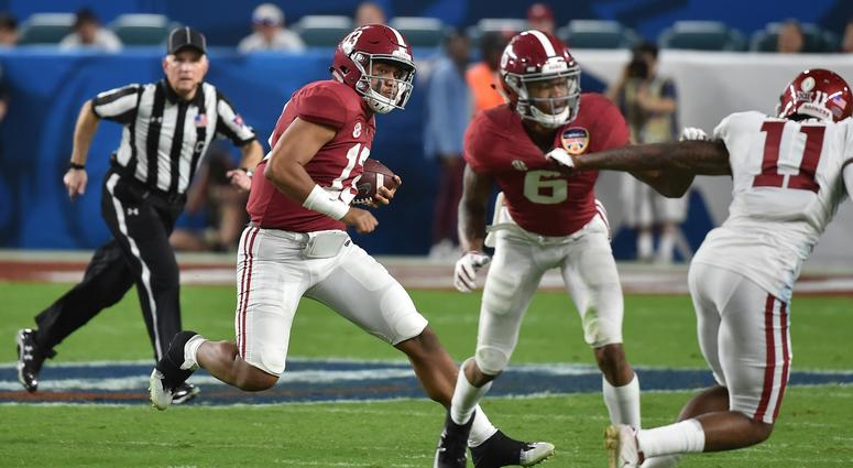 Alabama Crimson Tide quarterback Tua Tagovailoa (13) runs with the ball against the Oklahoma Sooners during the second half of the 2018 Orange Bowl college football playoff semifinal game at Hard Rock Stadium.