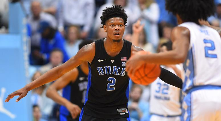 North Carolina Tar Heels guard Coby White (2) with the ball as Duke Blue Devils forward Cam Reddish (2) defends in the first half at Dean E. Smith Center.