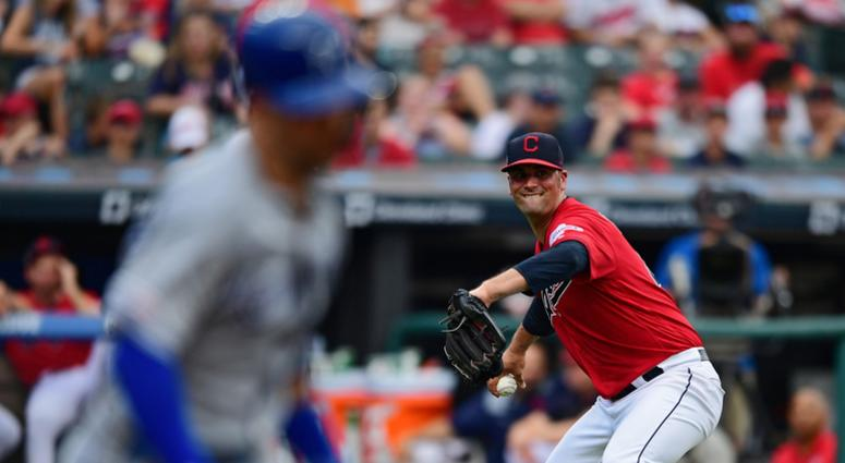 Jul 20, 2019; Cleveland, OH, USA; Cleveland Indians starting pitcher Adam Plutko (45) attempts to throw out Kansas City Royals right fielder Whit Merrifield (15) (not pictured) during the third inning at Progressive Field.