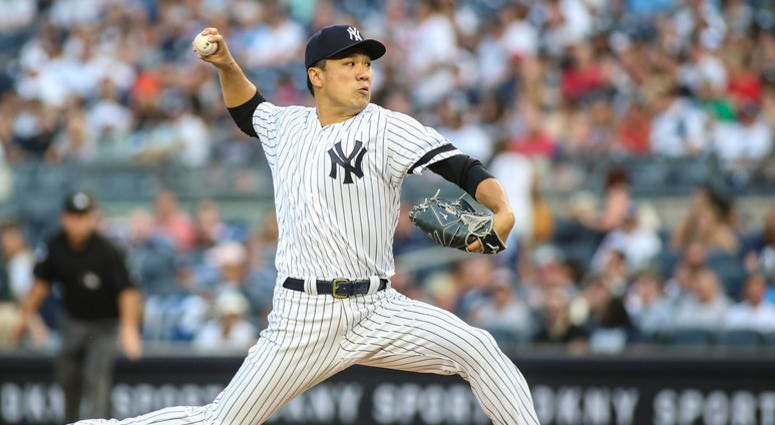 Aug 16, 2019; Bronx, NY, USA; New York Yankees pitcher Masahiro Tanaka (19) pitches in the first inning against the Cleveland Indians at Yankee Stadium. Mandatory Credit: Wendell Cruz-USA TODAY Sports