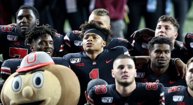 Ohio State Buckeyes quarterback Justin Fields (1) celebrates with teammates after the game against the Michigan State Spartans at Ohio Stadium.