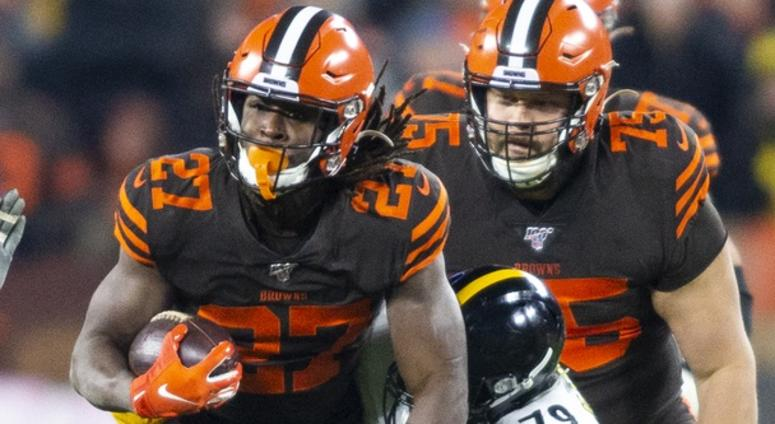 Cleveland Browns running back Kareem Hunt (27) runs the ball as Pittsburgh Steelers nose tackle Javon Hargrave (79) tackles m during the first quarter at FirstEnergy Stadium.